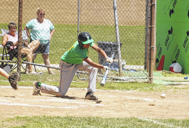 <strong>Will Miller lays down a bunt against Carroll in the bottom of the first inning.</strong>