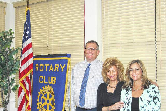 """<strong>Renate Frydman (center) is shown with the Rotary Speaker Sponsor for the Day Scott Rolfes (left) and Frydman's daughter Charlotte Golden (right).""""</strong>"""