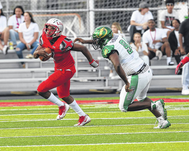 <strong>Northmont&#8217;s Bryan Heyward chases Lima Senior quarterback Rashaad Wallace during Friday night&#8217;s game at Spartan Stadium. </strong>