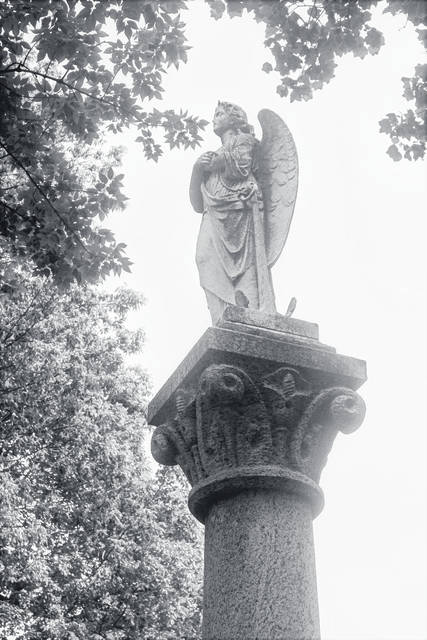 <strong>The monument above Matilda Stanley&#8217;s gravesite consists of a 20-foot granite column with the angel on top that is in need of repair and restoration.</strong>