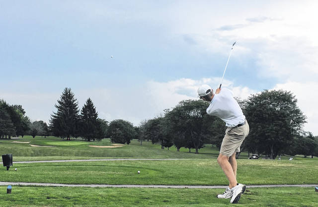 <strong>Alec Avdakov launches a tee shot on Hole 3 on the Meadowbrook at Clayton Golf Course during the match with Vandalia-Butler.</strong>