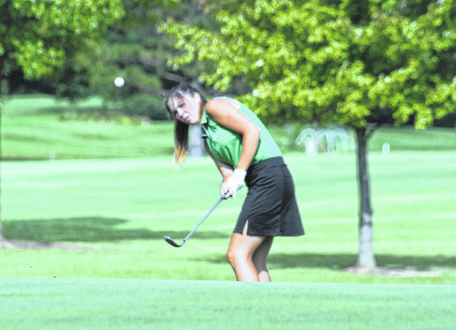 <strong>Carly Sherwood chips onto the green at Meadowbrook.</strong>