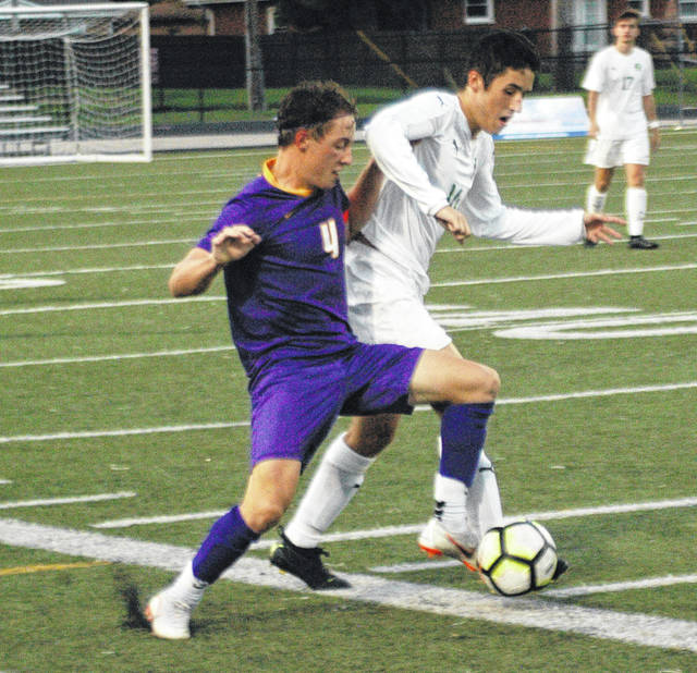 <strong>Butler's Matt Crawford tries to disrupt Justin Menker as he tries to move the ball past midfield.</strong>