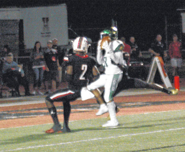 <strong>Danny Lewis hauls in a 35 yard touchdown pass in the third quarter for Northmont&#8217;s final score of the night against Wayne.</strong>