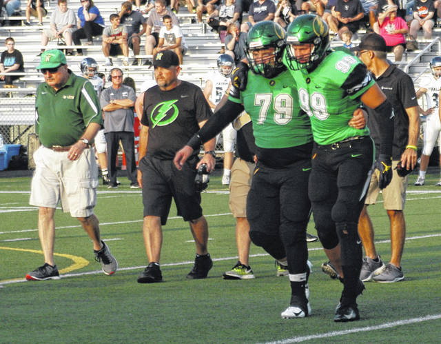 <strong>Gabe Newburg gets assisted off the field by David Weherley (79) after suffering an ankle injury.</strong>