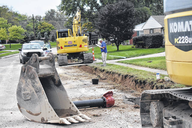 <strong>Work to install a new water main along the north side of Seville Drive was progressing late Wednesday afternoon.</strong>