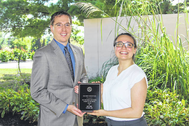 <strong>Alexandra Cline is shown receiving her Student of the Month award from Northmont High School Principal Dr. Jason Inkrott.</strong>