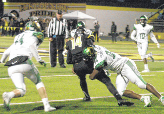 <strong>Bryan Heyward tackles Centerville wide receiver J.R. Melzer.</strong>