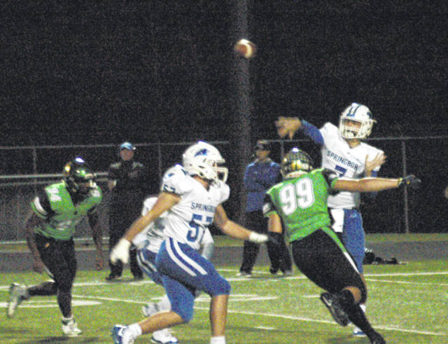 <strong>Bryan Heyward (94) and Gabe Newburg pressure Springboro quarterback Landon Palmer as he fires a pass completion to Kameron Dickerson.</strong>