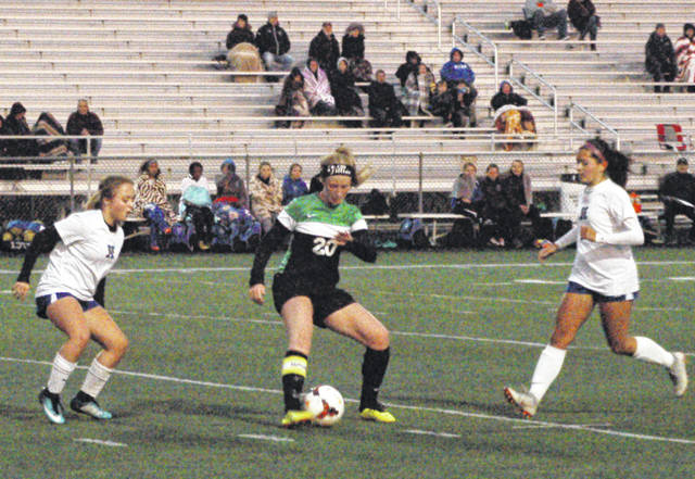 <strong>Jillian Naas dribbles the ball under pressure from a pair of Xenia defenders.</strong>