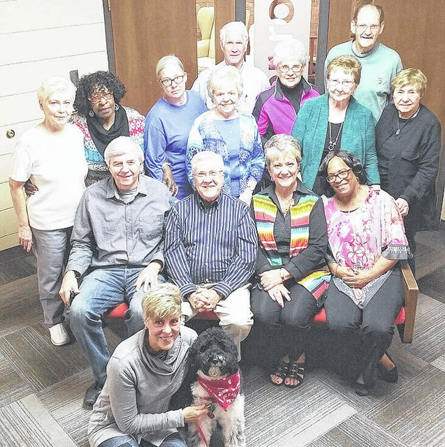 <strong>Light House program volunteers include (front row floor) Michelle Boots and therapy dog Bo Jangles; (front row seated) Pastor Richard Triplett, Pastor Dave Cox, Co-Director Pam Hall, Co-Director Cheryl Wheeler; (second row) Carol Flory, Gloria Allen, nurse Cathy McCoy, Jan Cox, Lois Cobb, Gretchen Berry; (back row) Ted Flory, Melinda Dexter and Jerry Berry. Volunteers not pictured are Nurse Melissa Green, Patty Ernst, Jill Kindred, Pat Bright and Rhonda Kegley.</strong>