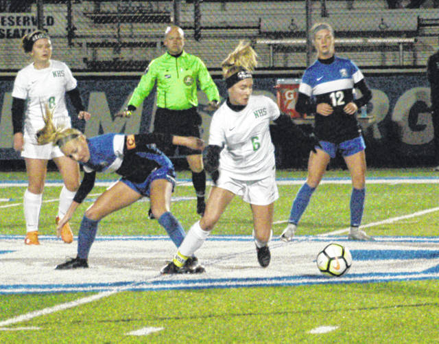 <strong>Samantha Roman maneuvers the ball away from Springboro defenders.</strong>