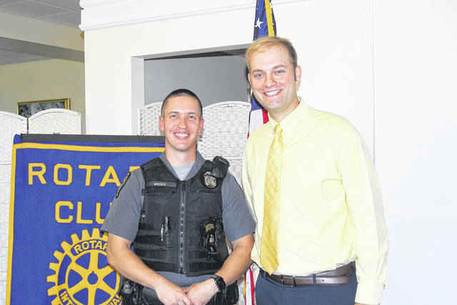 <strong>Pictured with Ohio State Highway Patrol Trooper Joe Weeks (left) is Rotary President-elect Brad Rarick.</strong>