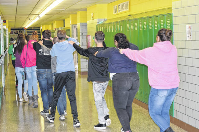 <strong>Students begin to evacuate Northmont Middle School during Wednesday&#8217;s Safety Drill.</strong>