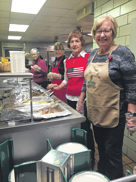 <strong>Left to right: Sheila Petteruti, Sandy Bakos, Terry Cannon, and Beryl Wilson of the Concord United Methodist Women's group at work in the kitchen at last year's annual Thanksgiving dinner.</strong>
