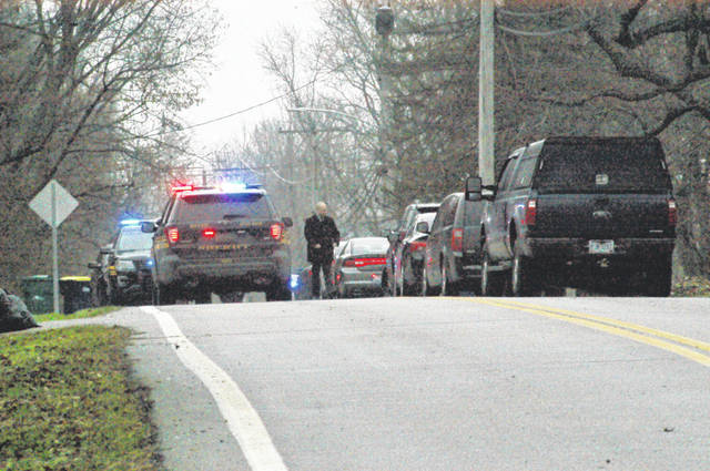 <strong>N. Diamond Mill Road was blocked off following a police pursuit that ended south of U.S. Route 40 early Friday afternoon. A suspect fired shots at the Clay Twp. Police Department and fled east into Clayton. After the pursuit the suspect exchanged gunfire with police and was wounded.</strong>