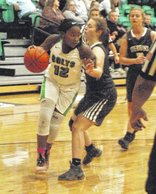 <strong>Amair Bradford muscles past Stebbins defender Katelynn Johnson.</strong>