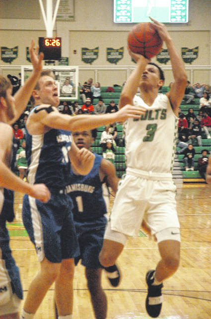 <strong>Sophomore Patrick Ivory scores Northmont's first basket of the game vs. Miamisburg.</strong>