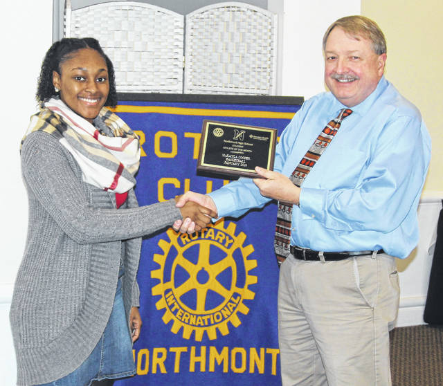 <strong>Northmont Team Physician Dr. Mike Barrow is shown presenting the Athlete of the Month award to Makayla Cooper.</strong>