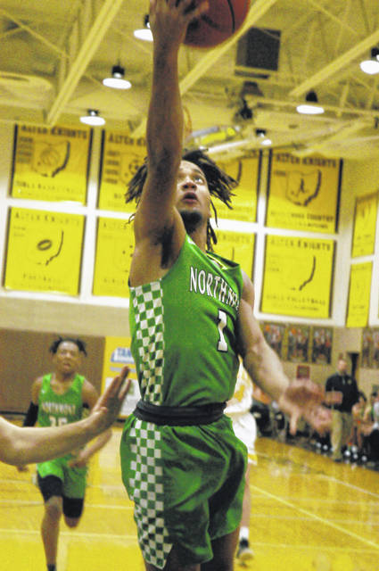 <strong>Danny Lewis scores a layup during the first half at Alter. Lewis led Northmont with 23 points including a game-winning 3-point field goal to secure the Thunderbolts 700th all-time victory.</strong>