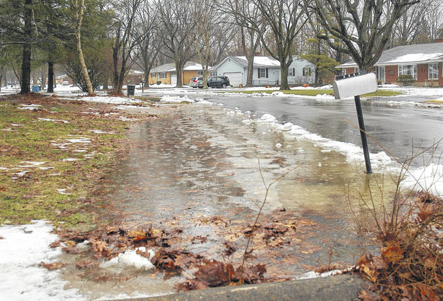 <strong>Melting snow and rain caused drainage ditches in the Clayton area to reach capacity Wednesday morning.</strong>