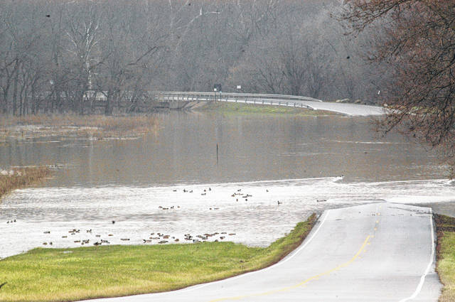 <strong>Martindale Road was closed to through traffic Tuesday due to the Stillwater River flooding from heavy rain on Monday. The road was still closed as of Wednesday afternoon. While the ducks in this photo enjoyed the high water some motorists did not enjoy having to take a different route to reach their destination.</strong>