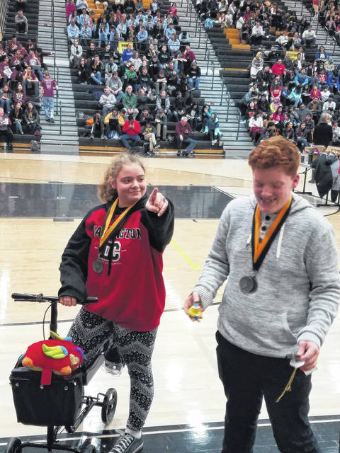 "<strong>Sydney Gross and Ben Loudenslager joke around after winning second place in ""Write It, Do It"" at the Centerville Science Olympiad Invitational last Saturday.</strong>"