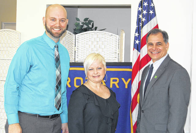 <strong>Pictured with Donna Cox are Rotary President Elect Brad Rarick (left) and Rotary President Tony Thomas.</strong>
