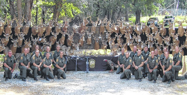 <strong>Investigators with the Ohio Division of Natural Resources pose with illegally harvested wildlife seized during Operation North Coast.</strong>