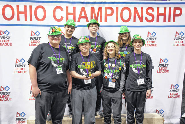 <strong>The Thunder-Bots pose with their First Place Gracious Professionalism award the team earned at the Ohio State Championship.</strong>