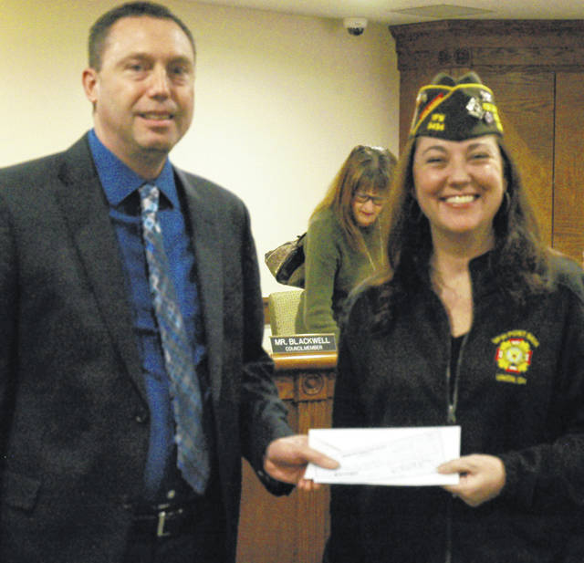 <strong>VFW Post 5434 Commander Angela Woods-Swartz presented a check for $200 to help fund the City of Union's annual Easter Egg Hunt to Councilman David Blackwell at Monday's city council meeting.</strong>