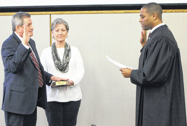 <strong>Judge Gerald Parker administers the Oath of Office for Auditor Keith as his wife Doris Keith holds the Bible.</strong>