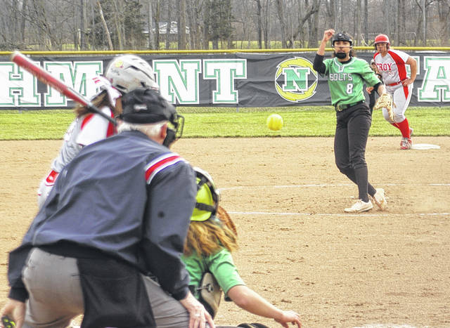<strong>Carmynn Bonner delivers a pitch to Troy batter Ella Furlong with Tia Bass on second base.</strong>