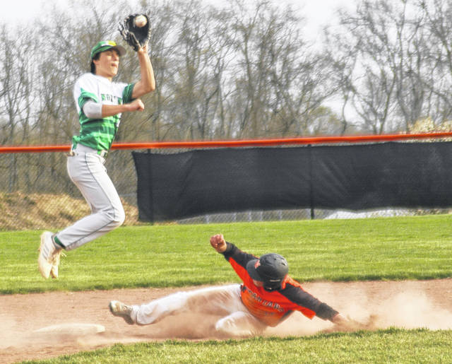 Photo by Ron Nunnari <strong>Waynesville junior Tanner Fannin slides in safe on a steal at second as Nick Newman leaps to take the throw.</strong>