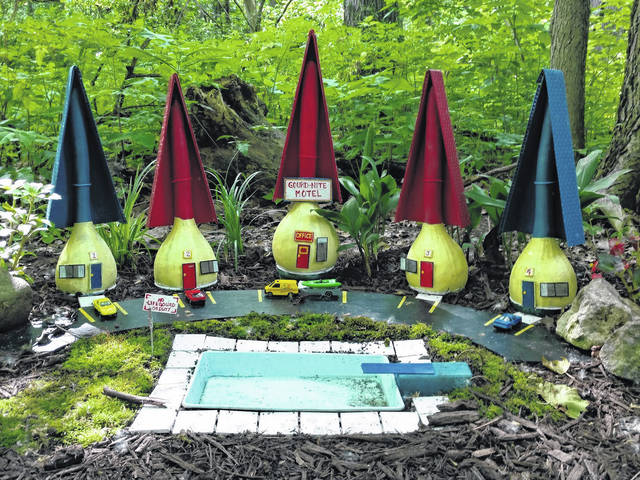 <strong>The Gourd-Nite Motel accommodates traveling Faeries and the Woodland Community houses the Faeries who live in tune with Nature.</strong>