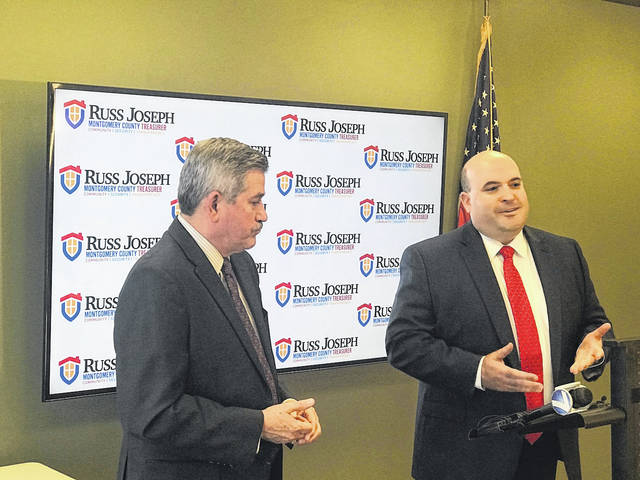 <strong>Montgomery County Auditor Karl Keith (left) and County Treasurer Russ Joseph during a press conference announcing that county residents can extend the due date of 2nd half real estate taxes by one year if their property lost more than 25 percent of its value as a result of the Memorial Day tornadoes.</strong>