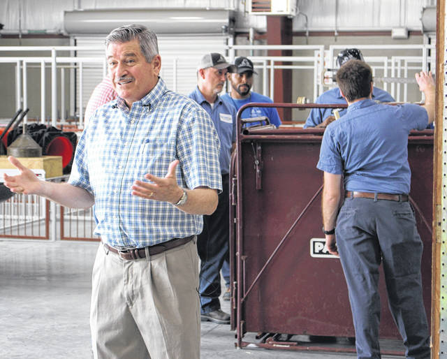 <strong>Montgomery County Auditor Karl Keith talks with fair officials while his inspectors check a scale.</strong> (Contributed photo)