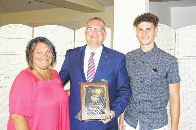 <strong>Scott Rolfes was the recipient of the 2019 Rotarian of the Year. He is shown with his wife Chassidy and son Logan.</strong> (Photo by Michael Barrow, M.D.)