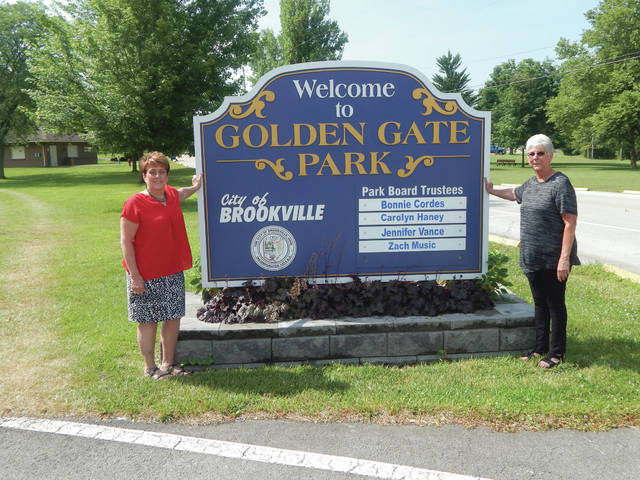 <strong>New Brookville city manager Sonja Keaton (left) is shown by the entrance to Golden Gate Park with Park Board President Bonnie Cordes.</strong> (Kevin O'Boyle | AIM Media Midwest)