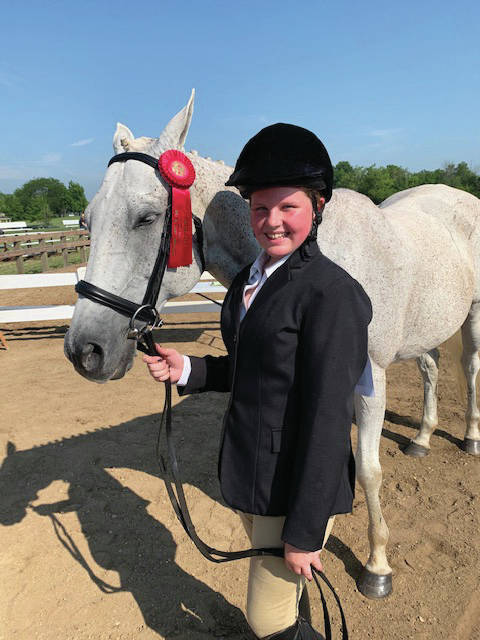 <strong>Kylah Skaroupka is shown with her horse Conner at the 2019 Montgomery County Fair.</strong> Photo contributed