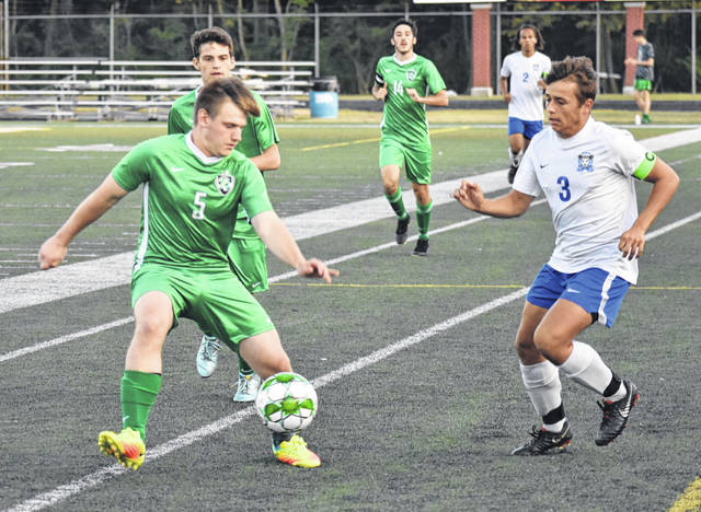<strong>Dylan Hellmund gains control of the ball as Springboro defender Andrew Blank closes in.</strong>