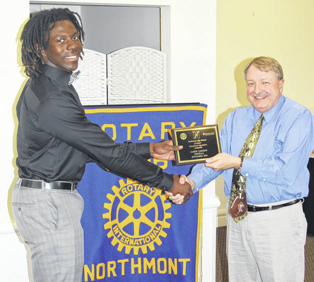 <strong>Jaiden Cameron is shown receiving his Athlete of the Month award from Northmont Team Physician Michael Barrow, M.D.</strong>