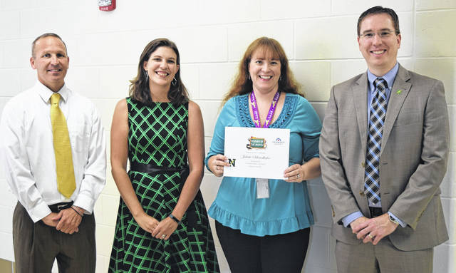 <strong>Northmont High School teacher Juliette Schmalhofer was named the Farmers Insurance Teacher of the Month for September. Pictured left to right: Assistant Principal Chad Kaltenbach, Farmers Agent Angie Clifford, Juliette Schmalhofer, and Principal Jason Inkrott.</strong>
