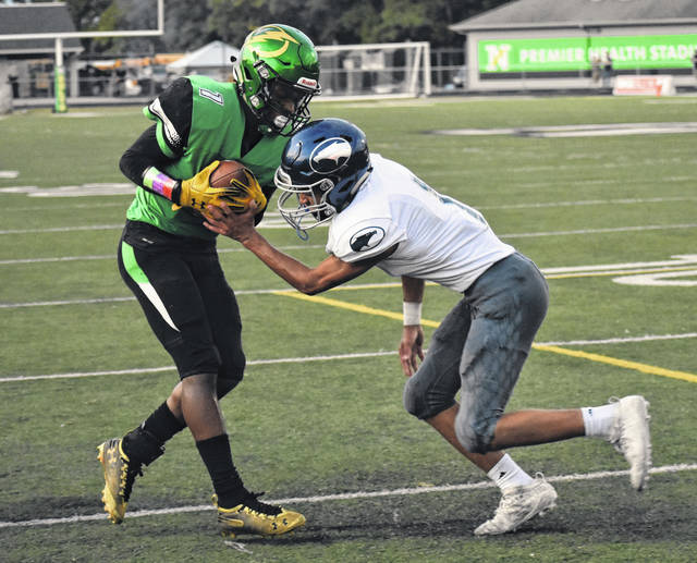 <strong>Justin Golson steps into the end zone in front of Fairmont defender Etham Saum to give Northmont a 14-7 second quarter lead.</strong>