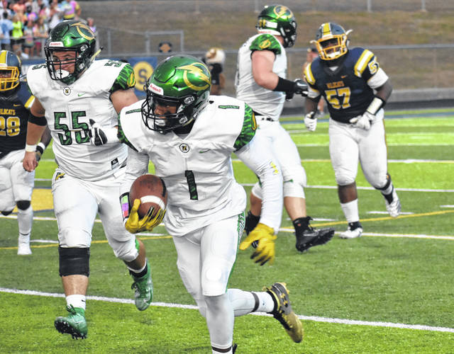 <strong>Justin Golson cuts outside after making a pass reception to give Northmont a first down.</strong>