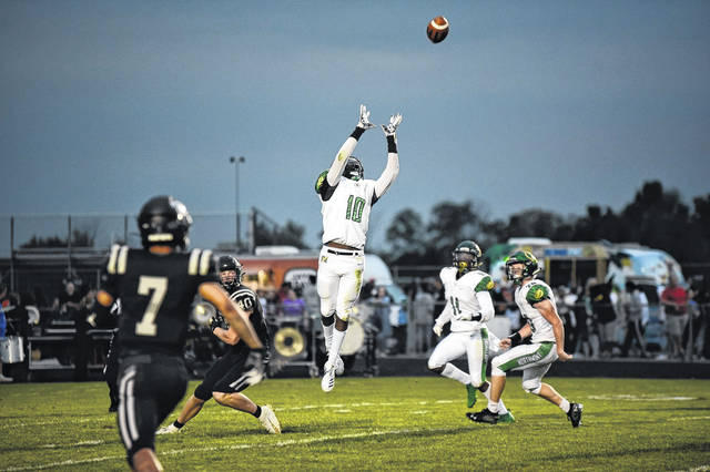 <strong>Defensive back Rod Moore leaps to make one of his three interceptions against Pickerington North.</strong>