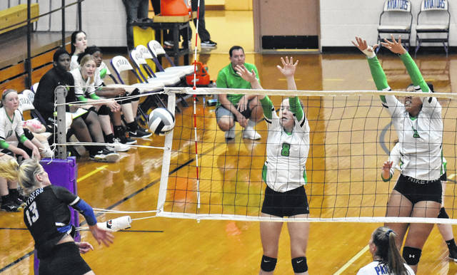 <strong>Paige Birdsall (left) and Alexis Boykin successfully block at shot Saturday during Northmont's loss to Springboro in the sectional tournament at Butler High School.</strong>