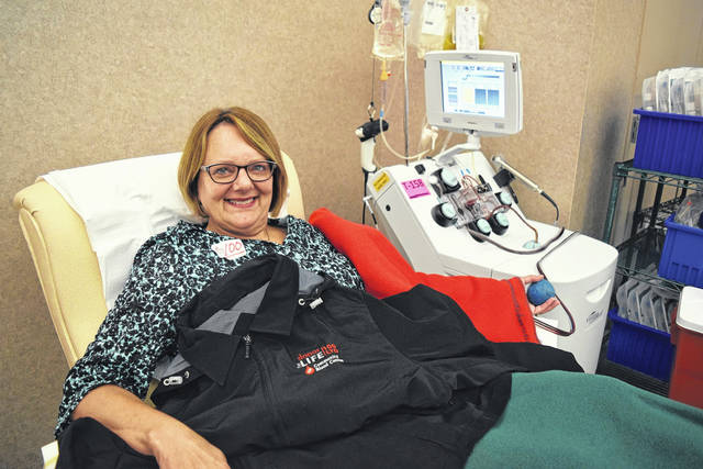 <strong>Englewood donor Carol Homan, a retired nurse, recently made her 100th lifetime donation at the Community Blood Center in Dayton.</strong>
