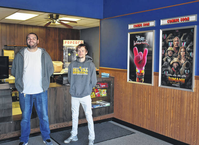 <strong>The new owners of Englewood Cinema, Luke Sowers (left) and George Rand stand in front of the snack bar of the recently renovated cinema.</strong>