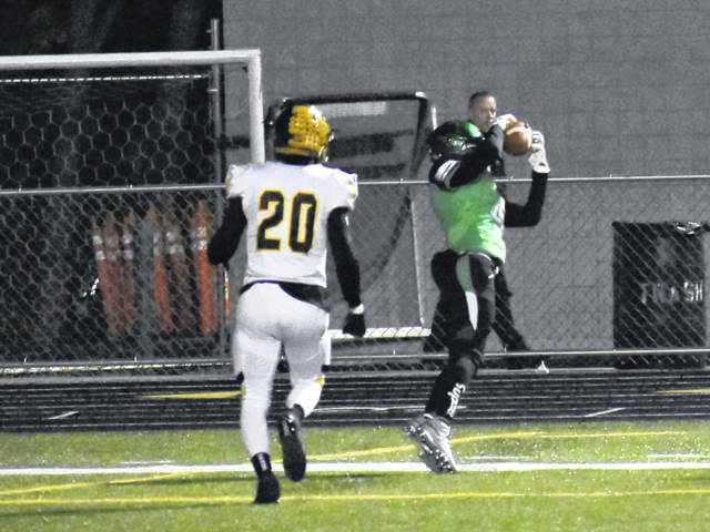 <strong>Jazz Keys gets both feet down on a 17 yard pass reception in the end zone to score Northmont's first touchdown against Centerville.</strong>